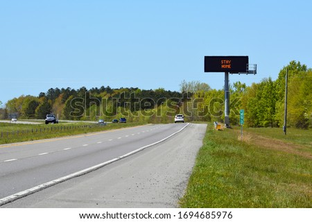 A highway sign in North Carolina tells people to stay home during the coronavirus covid-19 pandemic.