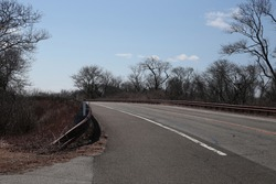A highway street in Long Island with blue skies.