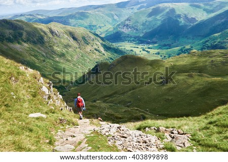 A hiker walking in the English Lake District, UK.