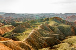 A hiking path fades into the distance at the Zhangye National Geopark in China