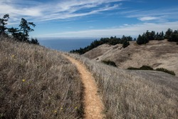 A hiking trail on Mount Tamalpais just north of San Francisco, California, in Marin, leads westward.  This area has many hiking trails used for recreation and is just above Stinson Beach.