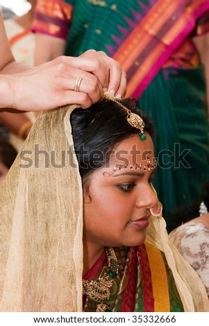 A Hindu bride during a pre=wedding ceremony