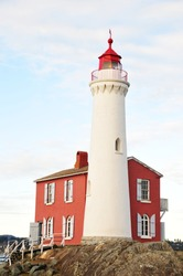 A historic lighthouse at seashore, it is the first lighthouse built in vancouver island in 1860, victoria, british columbia, canada