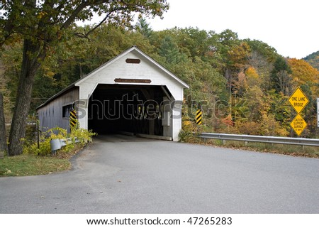 A historic New England covered bridge located in Dummerston Vermont.