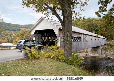 A historic New England covered bridge located in the United States.