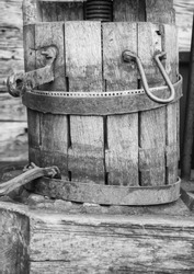 A historic wooden bucket with an iron ring