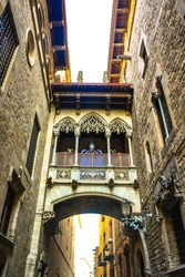 A historical Gothic bridge between buildings in Barri Gotic Quarter, Barcelona, Spain