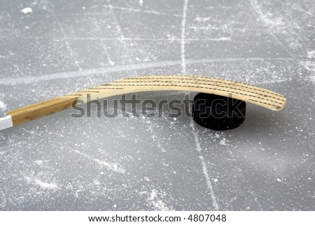 a hockey stick and puck on the ice