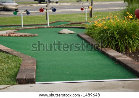 A hole at a miniature golf course