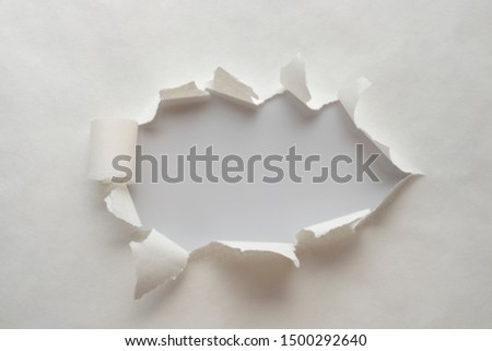 A hole in old paper with the sides torn off. with space for your message