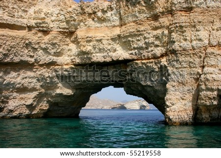 A hole in the mountain running into the sea. muscat, oman - stock photo
