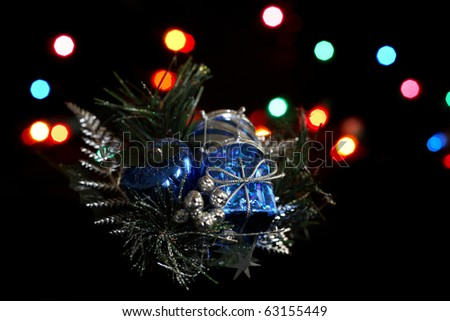 A holiday decoration in front of holiday colored lights