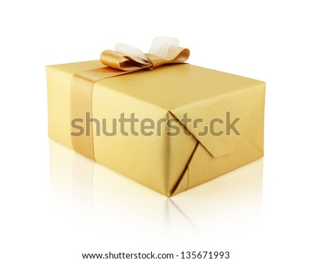 A holiday gift box in golden paper whith ribbon bow