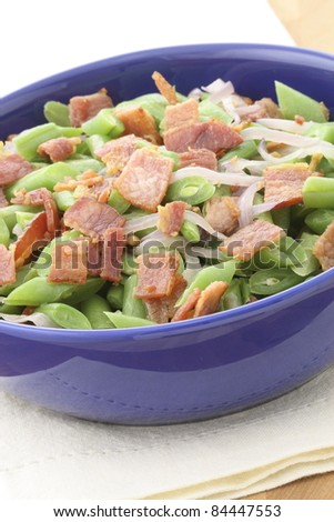 A holiday green bean casserole recipe, made with green beans, bacon or pancetta and sauteed shallots.