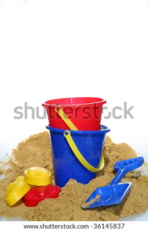 A holiday image of buckets and spades with sand from a beach