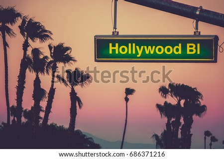 A Hollywood Blvd Sign At Sunset With Palm Trees In Los Angeles #686371216