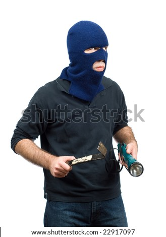 A home burglar isolated against a white background, holding a flashlight and a crowbar