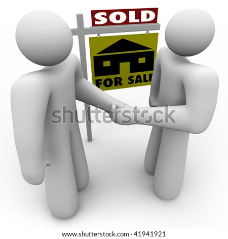 A home buyer and seller shake hands in front of a for sale sign that is marked Sold.