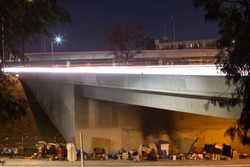 A homeless encampment under a Downtown Los Angeles freeway.