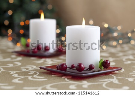 A horizontal image of dinner table with two lighted candle