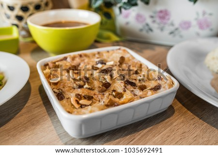 A horizontal image of Omo Ali; a popular dessert in Egypt. Pastry (bread, pastry or puff pastry) is divided into pieces and blended with pistachios, coconut flakes. #1035692491