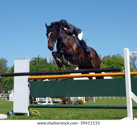 A horse and rider over a jump