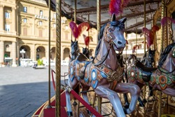 a horse on a merry-go-round in Florence