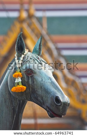 a horse statue with garland, Thailand