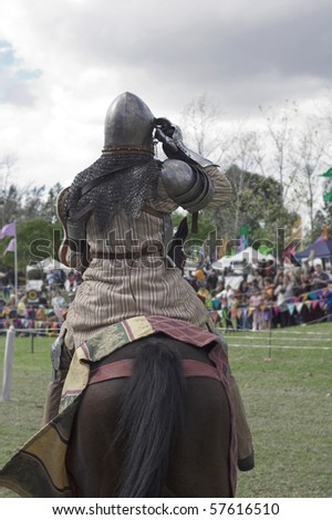 A horseman dressed as a medieval knight at a jousting competition.