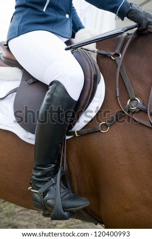 A horsewoman ready for a equestrian competition.