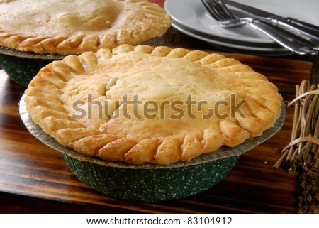 A hot chicken pot pie cooling on the table