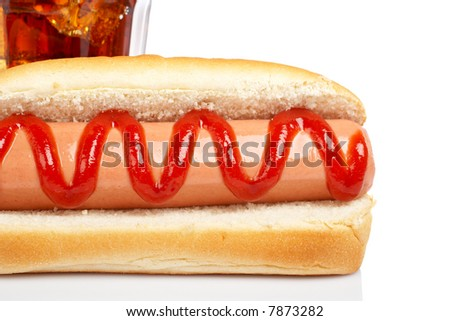 A hot dog and soda glass, reflected on white background. Shallow DOF