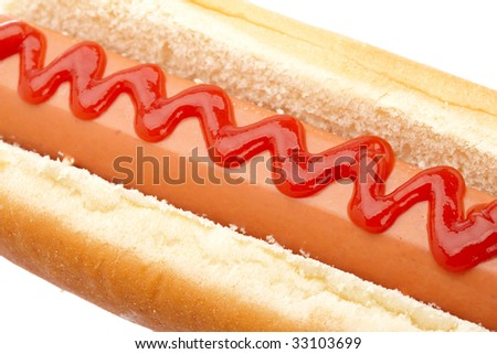 A hot dog with ketchup isolated on white background. Shallow depth of field
