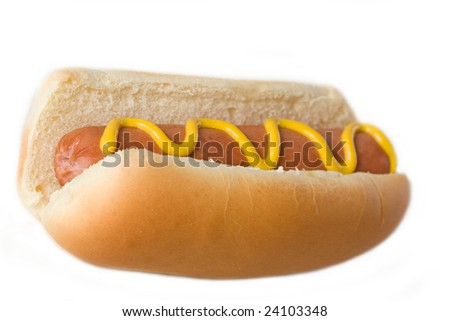 A hot dog with mustard - stock photo