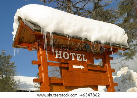 A Hotel Sign covered in Ice and Snow Bled Slovenia.