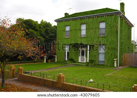 A house covered in grass promoting living green.