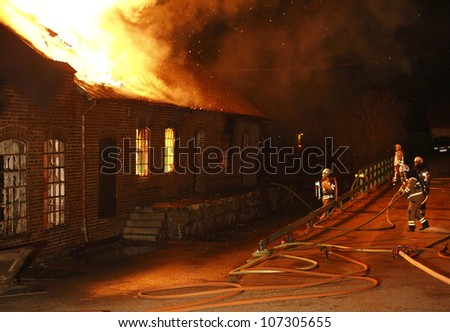 A house in Sweden burning down.