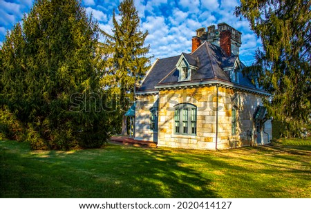 A house in the garden. Lodge in garden. Summer garden small house view. Small cottage house