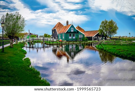 A house in the village by the river. Village on the river. River village house. Village house on river