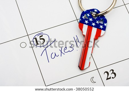 A house key on a calendar background, paying your taxes on time