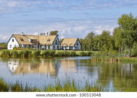 A house stands by the lakeside in the skane region of Sweden near to the village of Torekov.