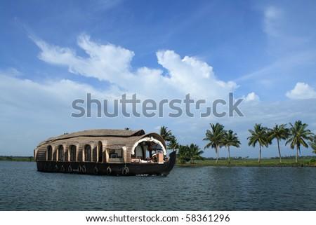 A houseboat cruises on the backwaters of Kerala, India