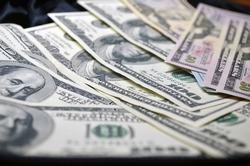 A huge amount of money. Dollars. Finance. Stocks, credit, debt, debit, business. Closeup American dollars banknotes background. US dollars pattern. 100 dollars, Mr. Franklin