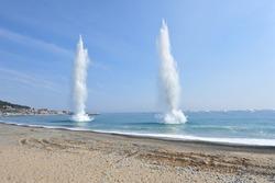 A huge column of water by Underwater demolition.