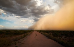 A huge dust storm/sand storm/haboob is covering the sky.