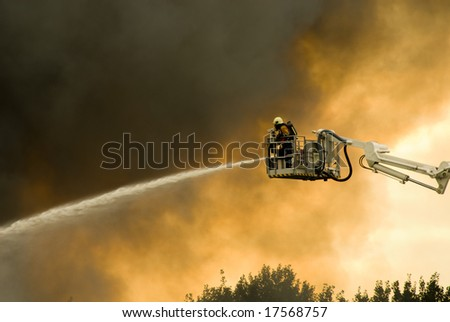 a huge fire with firefighters in action