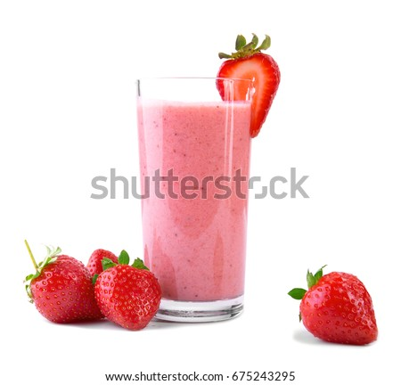 A huge glass with pink drinks or beverages from juicy and fresh red strawberries and organic milk and beautiful strawberries are around, isolated on a white background. Delicious pink smoothie.