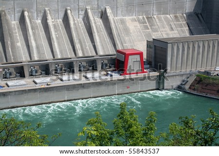 A huge hydro electric power plant on a river.