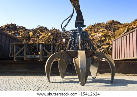 A huge mechanical claw, used to manipulate steel scrap on a scrapheap