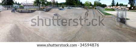 A huge panoramic image of an empty cement skate park